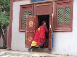Photo: Monks Entering Temple